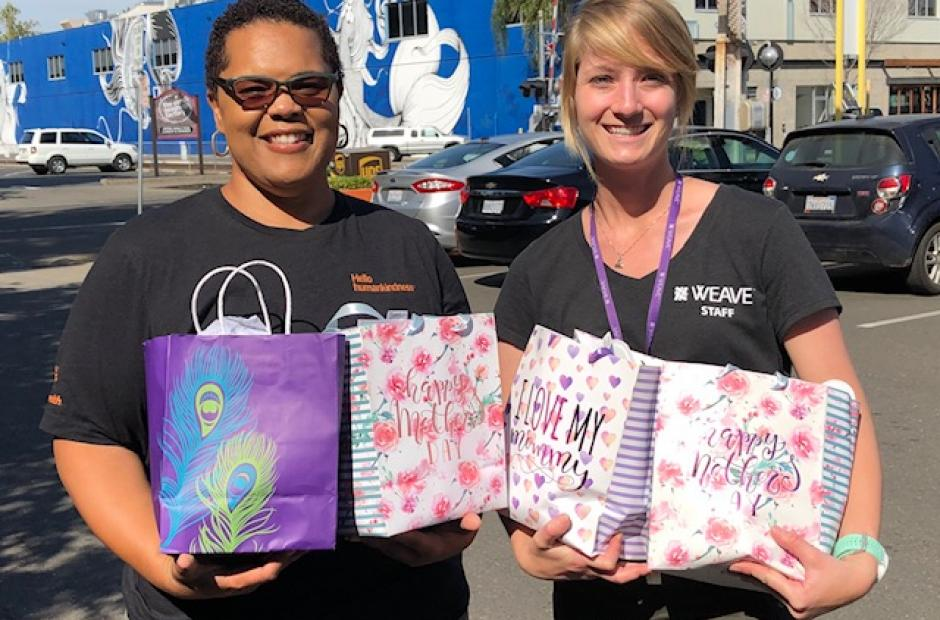 Dignity Health coworker and WEAVE coworker with Mother's Day bags