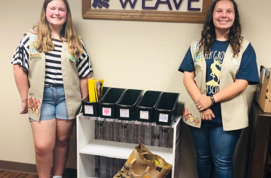 Girl Scout Troop 2690 and bookcase