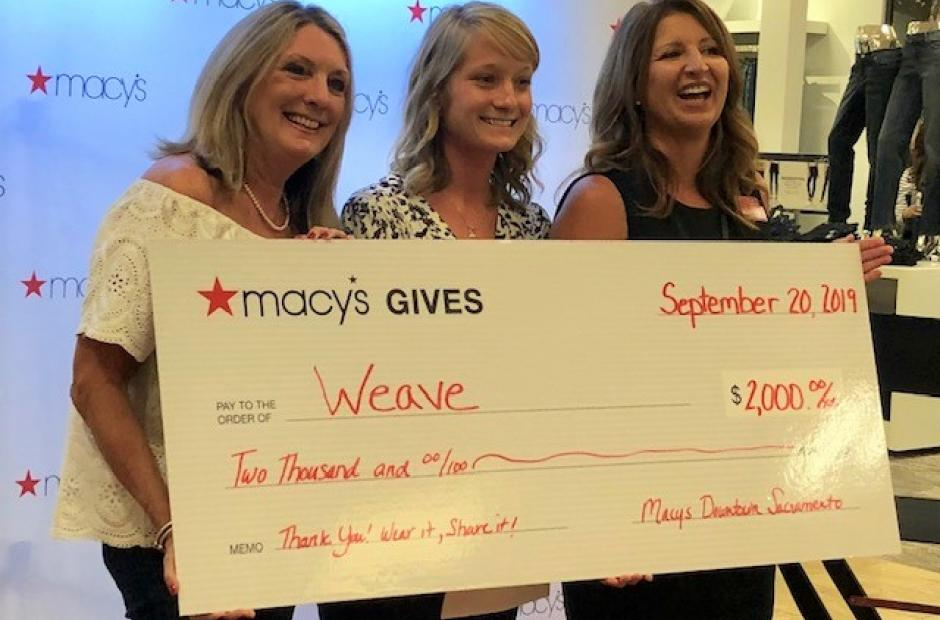 WEAVE team accepting check from Macy's