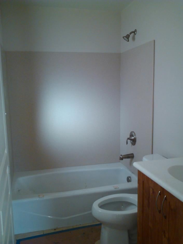 The bathroom space includes tub/shower option with one unit fully ADA compliant.
